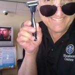 Getting ready to shave Anthony with a very sharp razor.
